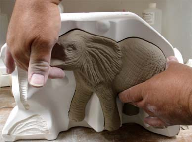 Removing elephant piece from the mold
